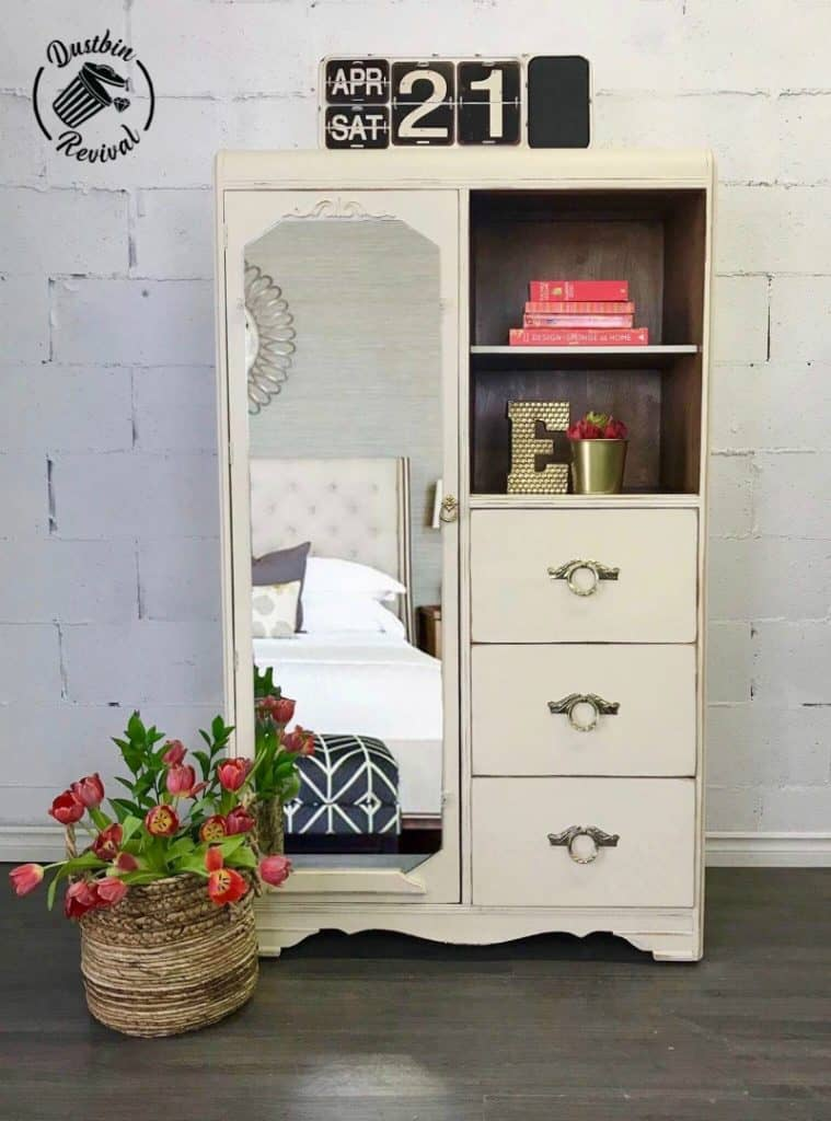 Classic Chifferobe painted with Cheesecake, a cream colour from Country Chic Paint. Full length beveled mirror reattached with new Art Deco clips open to a closet on the left. Two open shelves and three drawers on the right.